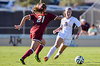 South Carolina defender/midfield Andie Romness (21) and Texas A&M forward Liz Keester (9) go after the ball during NCAA soccer game, Sunday, October 26, 2014 in College Station, Tex. South Carolina draw 2-2 against Texas A&M in double overtime. (Mo Khursheed/TFV Media via AP Images)
