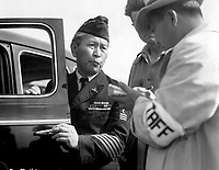 Dressed in uniform marking service in the first World War, this veteran enters Santa Anita Park assembly center for persons of Japanese ancestry evacuated from the West Coast.  Arcadia, CA.   April 5, 1942.  Dorothea Lange. (WRA)<br /> NARA FILE #:  210-G-3B-424<br /> WAR & CONFLICT #:  775