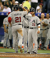 March 8, 2009:  David Wright (4) and Dustin Pedroia (15) greet Kevin Youkilis after a home run during the first round of the World Baseball Classic at the Rogers Centre in Toronto, Ontario, Canada.  Team USA defeated Venezuela  15-6 to secure a spot in the second round of the tournament.  Photo by:  Mike Janes/Four Seam Images