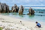 Boy fossicking for shells on the island of Nauru