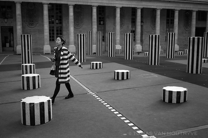A woman walks through Palais Royal in Paris, France, five days after coordinated terrorist attacks struck the heart of the French capital. Parks around the city have reopened.