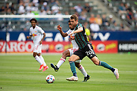 CARSON, CA - APRIL 25: Nick DePuy #20 of the Los Angeles Galaxy moves to the bal during a game between New York Red Bulls and Los Angeles Galaxy at Dignity Health Sports Park on April 25, 2021 in Carson, California.