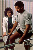 Patient with physical therapist.