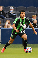 KANSAS CITY, KS - MAY 9: Nick Lima #24 Austin FC with the ball during a game between Austin FC and Sporting Kansas City at Children's Mercy Park on May 9, 2021 in Kansas City, Kansas.