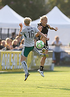 Erin Walter (16) and Lindsay Massengale (23) leap for the ball. FC Gold Pride tied the St. Louis Athletica 1-1 at Buck Shaw Stadium in Santa Clara, California on August 9, 2009.