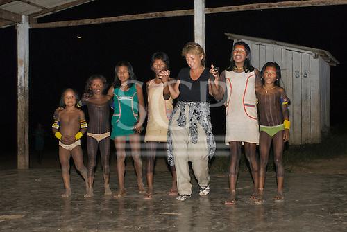 Pará State, Brazil. Aldeia Pukararankre (Kayapo). Sue Cunningham dancing with the women.