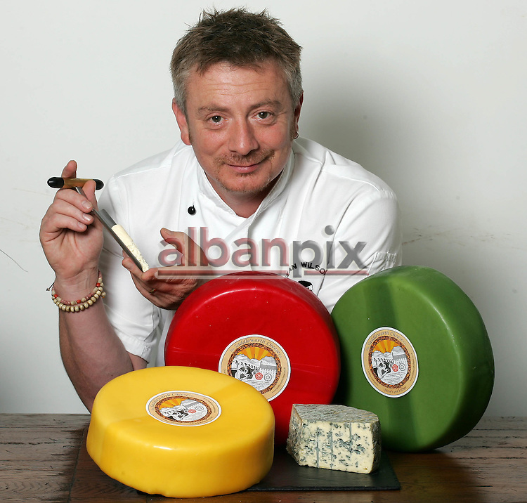 Coronation Street actor Sean Willson with his award winning Cheese  made at the Saddleworth Cheese co