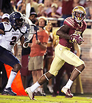 Florida State wide receiver Tamorrion Terry looks over his shoulder after 27 yard pass and Florida State's first touchdown during an NCAA college football game in Tallahassee, Fla.,Saturday, Sept. 8, 2018.  Florida State defeated Samford 36 to 26.