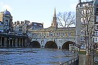 Bath: Pulteney Bridge, Avon River at flood level. Palladian style designed by Robert Adam.