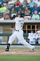 Slade Heathcott (26) of the Charlotte Knights follows through on his swing against the Scranton/Wilkes-Barre RailRiders at BB&T BallPark on July 20, 2016 in Charlotte, North Carolina.  The RailRiders defeated the Knights 14-2.  (Brian Westerholt/Four Seam Images)