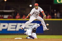 September 24, 2008: Los Angeles Angels of Anaheim shortstop Erick Aybar  leap frogs a hard slide by Seattle Mariners' Raul Ibanez at Safeco Field in Seattle, Washington.