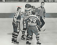 1974 FILE PHOTO - ARCHIVES -<br /> <br /> Well-earned accolade: Bobby Hull (16) receives congratulations from Team Canada linemate Andre Lacroix (7) after scoring his second goal to tie game; 3-3; last night. Moving in to add praise are Rick Ley (2) and Johnny McKenzie (23). McKenzie scored first goal of game on play set up by Hull and Lacroix.<br /> <br /> PHOTO : Ron BULL - Toronto Star Archives - AQP