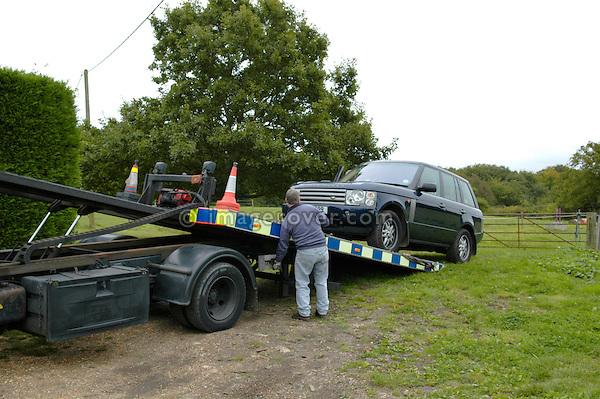 Recovering a broken Range Rover 3rd generation. England, UK, 2005.