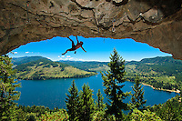 Rockclimber on the ceiling of the amphitheatre above Horne Lake on Vancouver Island, British Columbia, Canada. Model Released.