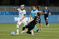 SAN JOSE, CA - SEPTEMBER 19: Florian Jungwirth #23 of the San Jose Earthquakes goes for a tackle on Cristhian Paredes #22 of the Portland Timbers during a game between Portland Timbers and San Jose Earthquakes at Earthquakes Stadium on September 19, 2020 in San Jose, California.