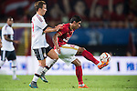 (R) Paulinho of Guangzhou Evergrande being followed by (L) Mario Gotze of Bayern Munichduring the Bayern Munich vs Guangzhou Evergrande as part of the Bayern Munich Asian Tour 2015  at the Tianhe Sport Centre on 23 July 2015 in Guangzhou, China. Photo by Aitor Alcalde / Power Sport Images