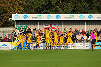 9th October 2021;  VBS Community Stadium, Sutton, London; EFL League 2 football, Sutton United versus Port Vale; Sutton United players celebrate scoring from Rowe for 4-3 in stoppage time in front of Port Vale fans.