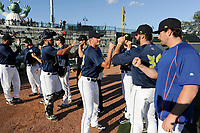 Starting pitcher Gary Cornish (23) of the Columbia Fireflies, center, high-fives teammates before a game against the Lexington Legends on Thursday, June 8, 2017, at Spirit Communications Park in Columbia, South Carolina. Columbia won, 8-0. (Tom Priddy/Four Seam Images)