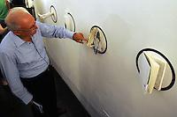 """Galleria 291 est, nello storico quartiere di San Lorenzo, Roma..Gallery 291 East, in the historical district of San Lorenzo, Rome..Eugenio Pozzilli, grafico, presenta il suo personaggio """"Pupazzillo"""" ..Eugenio Pozzilli, graphic artist, introduce his character  """"Pupazzillo"""" ."""