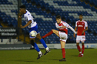 Fleetwood Town's Harrison Biggins (right) sees his shot is blocked by Rohan Ince (left) during the The Checkatrade Trophy match between Bury and Fleetwood Town at Gigg Lane, Bury, England on 9 January 2018. Photo by Juel Miah/PRiME Media Images.