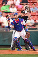 Buffalo Bisons catcher Mike Nickeas (15) and umpire Jonathan Bailey during a game against the Gwinnett Braves on May 13, 2014 at Coca-Cola Field in Buffalo, New  York.  Gwinnett defeated Buffalo 3-2.  (Mike Janes/Four Seam Images)