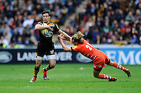 Alex Lozowski of Wasps escapes the tackle attempt of Sam Harrison of Leicester Tigers