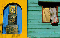 A window is seen at Caminito St. in the popular neighbourhood of La Boca, in Buenos Aires May 18, 2003. Carlos Gardel, the biggest start of tango from all times dedicated a song to this street. Today craftsmen, painters, dancers and musicians, give to this typical street a colourful life of tango. Photo by Quique Kierszenbaum