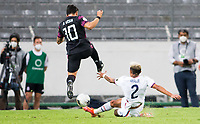 GUADALAJARA, MEXICO - MARCH 24: Henry Kessler #3 of the United States slide tackles Vladimir Loroña #2 of Mexico during a game between Mexico and USMNT U-23 at Estadio Jalisco on March 24, 2021 in Guadalajara, Mexico.