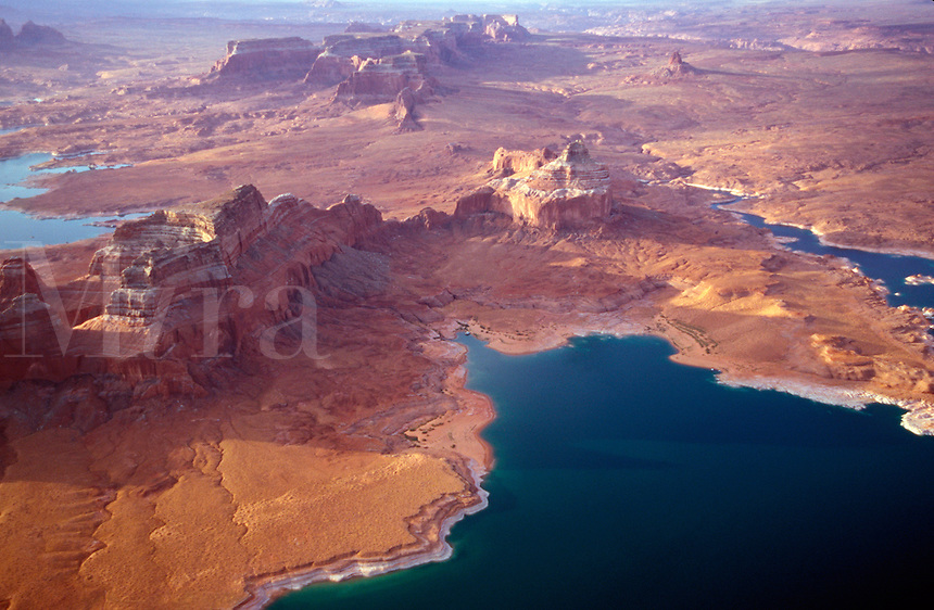 The waters of Lake Powell fill in the canyons and depressions of this ancient desert landscape