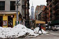 NEW YORK, NEW YORK - FEBRUARY 4:  <br /> A woman walks by a makeshift cabin at a local restaurant on February 12, 2021 in New York City. New York City is getting back their indoor dining with a restriction of 25 percent capacity. most of the restaurants have set up outdoor dining structures like pods, bubbles and lot of makeshift cabins . (Photo by Eduardo MunozAlvarez/VIEWpress)