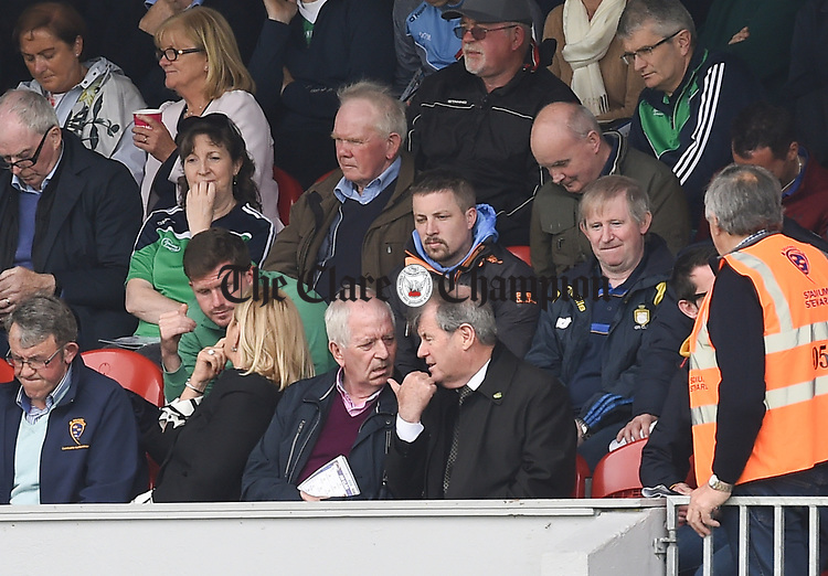 Former minister for finance Charlie Mc Creevey chatting with Limerick's JP Mc Manus at half time during the Munster championship game in Ennis. Photograph by John Kelly.