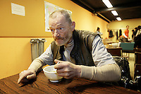 Switzerland. Geneva. Poverty in Geneva. Arnold Masy, 68 years old, from Belgium. Homeless. He sleeps every night in the underground bunker of the civil defense. The shelter is located at 35, rue des Vollandes in the Eaux-Vives area and is ran in the winter (november18 to march31) by the city of Geneva. Arnold Masy is eating a bowl of soup. Model Released. © 2005 Didier Ruef