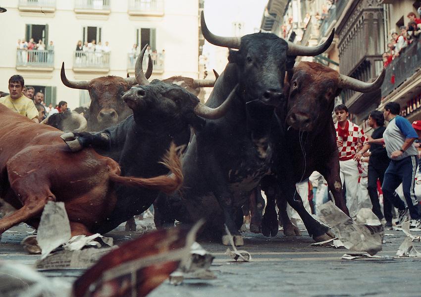 Miura bulls run during a bull run in Iruña / Pamplona..Photo: Ander Gillenea