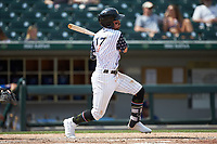 Danny Mendick (17) of the Charlotte Knights follows through on his swing against the Durham Bulls at BB&T BallPark on May 27, 2019 in Charlotte, North Carolina. The Bulls defeated the Knights 10-0. (Brian Westerholt/Four Seam Images)