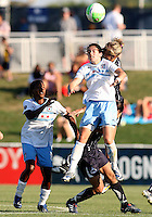 Allie Long #9 of the Washington Freedom goes up for a high ball with Karen Carney #14 of the Chicago Red Stars during a WPS match on July 4 2010 at the Maryland Soccerplex, in Boyds, Maryland. The match ended in a 0-0 tie.