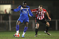 Sherwin Stanley of Aveley and Elliot Styles of Hornchurch - AFC Hornchurch vs Aveley - Ryman League Premier Division Football at The Stadium - 08/03/11 - MANDATORY CREDIT: Gavin Ellis/TGSPHOTO - Self billing applies where appropriate - Tel: 0845 094 6026