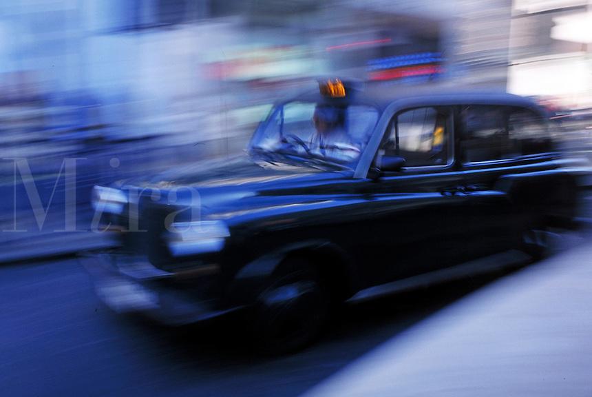 Taxicab on street of London, England. London, England.