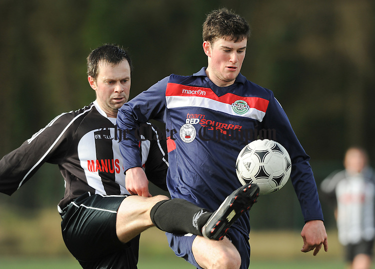 Danny Scanlan of Manus Celtic in action against John Scanlan of Mountshannon during their Clare League game at Lees Road. Photograph by John Kelly.