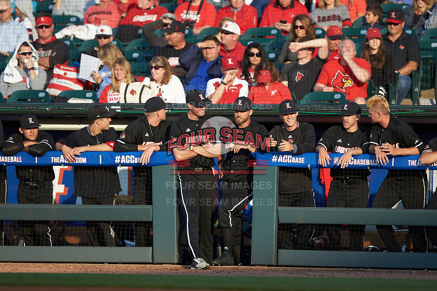The Louisville Cardinals bench watches from the dugout during the game against the Notre Dame Fighting Irish in Game Eight of the 2017 ACC Baseball Championship at Louisville Slugger Field on May 25, 2017 in Louisville, Kentucky. The Cardinals defeated the Fighting Irish 10-3. (Brian Westerholt/Four Seam Images)