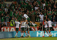 James McClean of Ireland is mobbed by team mates celebrating his opening goal during the FIFA World Cup Qualifier Group D match between Wales and Republic of Ireland at The Cardiff City Stadium, Wales, UK. Monday 09 October 2017