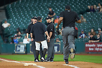 Sam Houston State Bearkats head coach Matt Deggs argues a call with umpires Ken Langford (left) and Aaron Freeman (right) as home plate umpire Joe Harris hustles to join the fray during the game against the Mississippi State Bulldogs during game eight of the 2018 Shriners Hospitals for Children College Classic at Minute Maid Park on March 3, 2018 in Houston, Texas. The Bulldogs defeated the Bearkats 4-1.  (Brian Westerholt/Four Seam Images)
