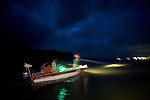 Boat with Guido Westhoff spotlighting the water surface looking for sea snakes
