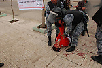 SULAIMANIYAH, Police help a wounded protester after security forces open fired on a demonstration...Kurdish security forces shot and killed protesters in the northern Iraqi city of Sulaimaniyah...Photo by Sartep Osman