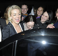 "SHERIDAN SMITH .Departed after the first preview performance of ""Flare Path"", Haymarket, London, England, UK, 4th March 2011..portrait headshot fans smiling mouth open funny laughing   black  eyes shut .CAP/CAN.©Can Nguyen/Capital Pictures."