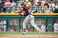 Leury Bonilla (4) of the Tacoma Rainiers at bat against the Salt Lake Bees in Pacific Coast League action at Smith's Ballpark on July 9, 2014 in Salt Lake City, Utah.  (Stephen Smith/Four Seam Images)