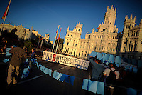 """Protestors hold a banner reading """"Bankers out of Power"""" as they march in Madrid on September, 2012. Hundreds of Spaniards marched in Madrid on Saturday to protest over hardships in a recession brought on by the financial crisis that they blame on banks and corrupt politicians. ©  Pedro ARMESTRE"""
