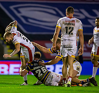 13th November 2020; The Halliwell Jones Stadium, Warrington, Cheshire, England; Betfred Rugby League Playoffs, Catalan Dragons versus Leeds Rhinos; Sam Tomkins of Catalans Dragons is tackled by James Donaldson of Leeds Rhinos