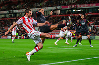 1st October 2021;  Bet365 Stadium, Stoke, Staffordshire, England; EFL Championship football, Stoke City versus West Bromwich Albion; Joe Allen of Stoke City crosses the ball in front of Jake Livermore of West Bromwich Albion