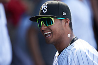 Lenyn Sosa (25) of the Winston-Salem Dash laughs as he listens to Eloy Jimenez (not pictured) talk prior to the game against the Hickory Crawdads at Truist Stadium on July 10, 2021 in Winston-Salem, North Carolina. (Brian Westerholt/Four Seam Images)