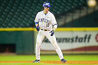 J.T. Riddle #10 of the Kentucky Wildcats takes his lead off of first base against the Houston Cougars at Minute Maid Park on March 5, 2011 in Houston, Texas.  Photo by Brian Westerholt / Four Seam Images